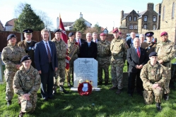 Paul Weston (centre behind headstone) pictured at his brother's grave with a number of army and CCF representatives as well as former colleagues of Father Weston.