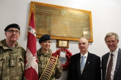 Paul Weston (second right) next to the plaque put up at the College in his brother's honour, pictured with (from left)  CCF Contingent commander Niall Rothnie, CCF standard-bearer Georgina Duncan and St Mary's principal Mike Kennedy.